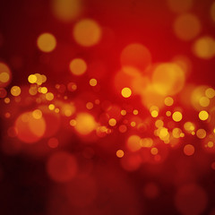 Orange bokeh lights on dark red background
