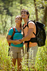 Couple is doing trekking in the woods