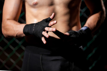 Hand Wrap in a fighting cage