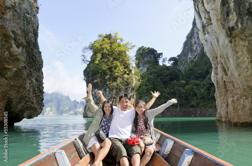 Leinwanddruck Bild Happy family travel boat ( Guilin of Thailand )