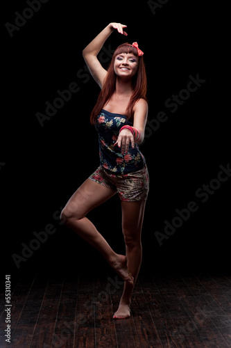 smiling female dancer showing move