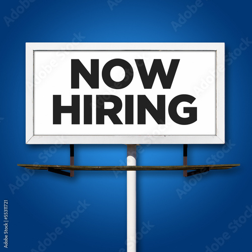 Now Hiring Billboard Sign on Blue Background