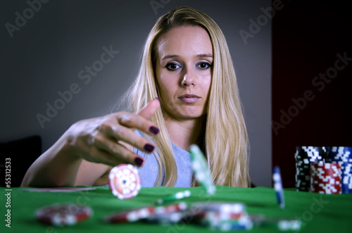 woman throwing poker chips on the table