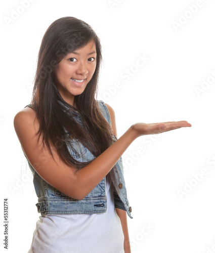 Presenting asian woman on a white background