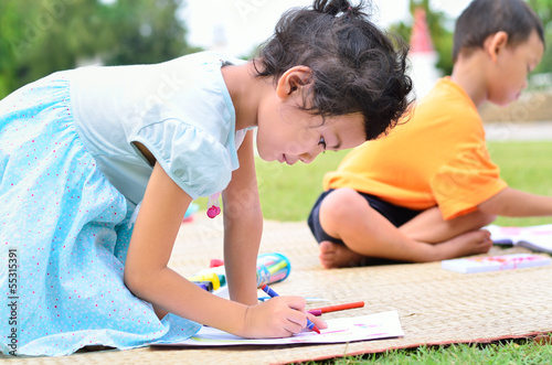 Going back to school, Children drawing and painting over green g