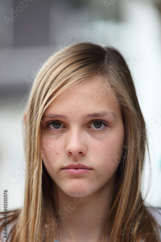 Young teenage girl with a serious expression