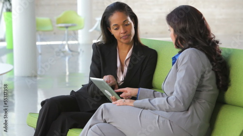 Businesswomen On Sofa And Using Digital Tablet