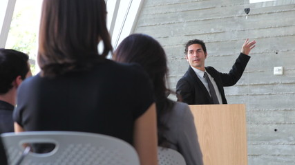 Businessman Giving Presentation At Conference