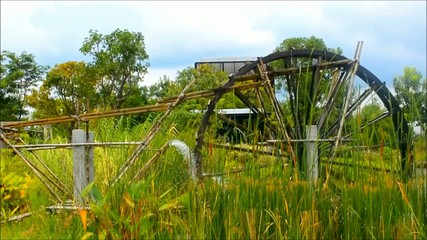 Waterwheel in green eco garden
