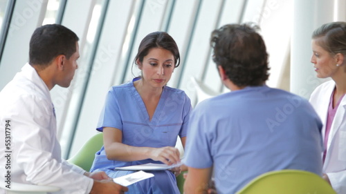 Medical Staff Meeting To Review Patient Notes