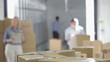 Shallow Focus Of Workers Taking Boxes From Belt