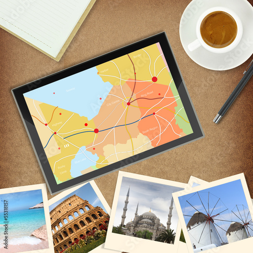 Tablet computer with gps map and photos of famous places
