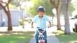 Boy Riding Bike Towards Camera