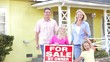 Family Standing By For Sale Sign Outside Home