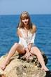 sensual woman near sea