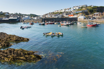 Mevagissey Cornwall England rowing boats in the harbour