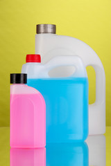 Liquids for car in canisters on green background