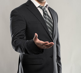 Successful businessman giving hand to business partner