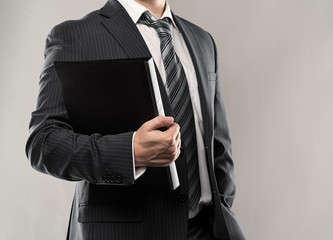Confident businessman holding a black folder