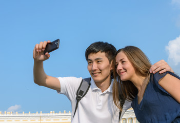 Tourists taking self-portrait pictures
