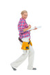 Blonde woman standing while playing with a spirit level