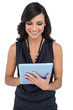 Smiling elegant brown haired model typing on tablet