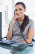 Smiling secretary answering land line