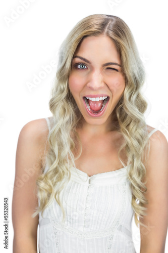 Cheerful blue eyed model winking at camera