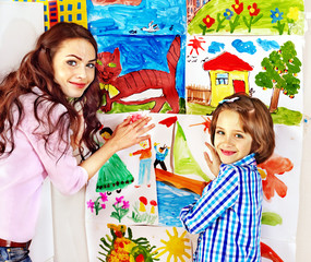 Family with child painting .