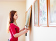 Long-haired girl hanging  pictures