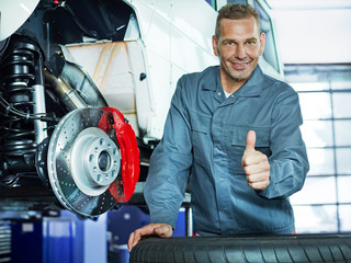 Master mechanic shows thumb up