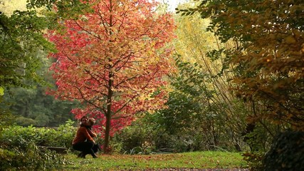 Comforting hug in park , autumn
