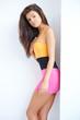 Sexy woman posing in mini skirt