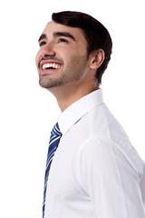 Happy corporate male looking upwards