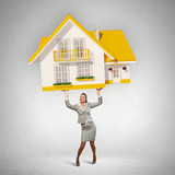 Businesswoman holding model of house