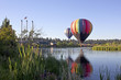 Leinwanddruck Bild - Rainbow hot air balloon in The Old Mill district, Bend, Oregon