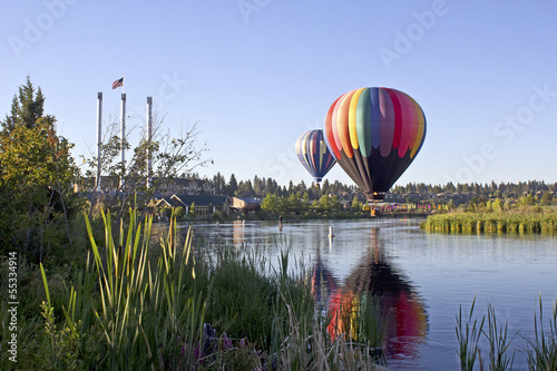 Leinwanddruck Bild Rainbow hot air balloon in The Old Mill district, Bend, Oregon