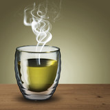 Glass of Green Tea on wood table