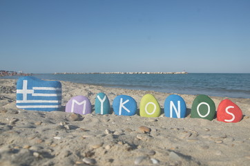 Souvenir of the greek isle Mykonos on colourful stones
