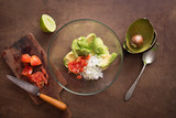 Preparing homemade guacamole on wooden table