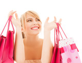 happy woman with many shopping bags