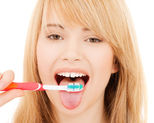 teenage girl with toothbrush