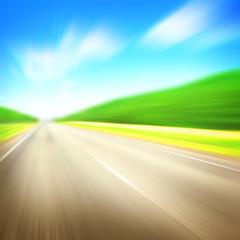 Motion blurred asphalt road.