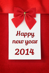 Happy new year 2014 greeting card on red wool background