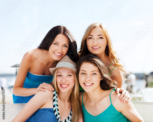 group of girls in cafe on the beach