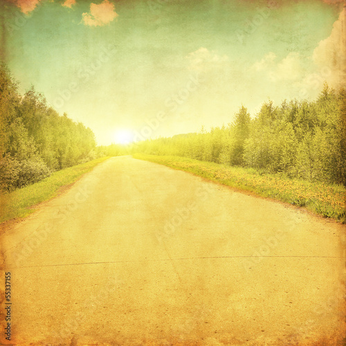Rural road through the forestat sunset.Grunge and retro style.