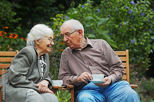 canvas print picture aged couple on the garden bench