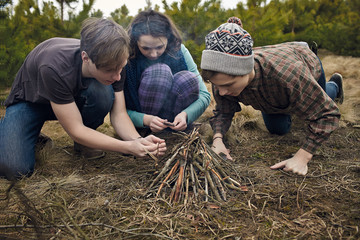 Group of teenagers set campfire