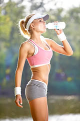 Fit woman in nature in spring
