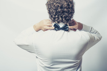 Bow tie on the back side. Strange or fun concept. Back view of